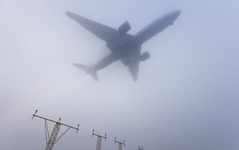 Tens of thousands of airline passengers are starting the New Year a long way from where they hoped to be due to heavy fog in south-east England, which led to dozens of flight cancellations.